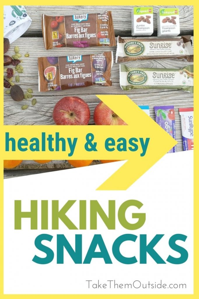 various snacks like apples, oranges, and granola bars all perfect hiking snacks