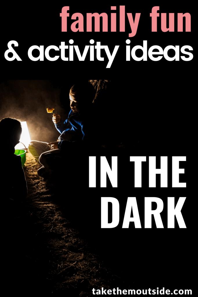 kids in the dark huddled around a lantern