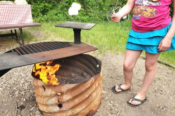 girl roasting marshmallows over the campfire